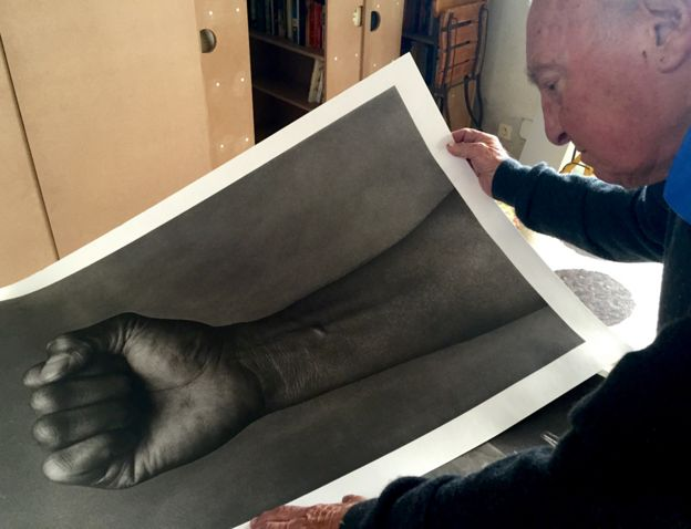 Stewart looks at one of his photographs