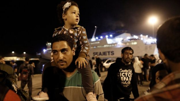 Syrian refugees disembark a ferry at the port of Piraeus, near Athens, Greece, 01 September 2015.