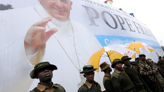 Soldiers patrol during a mass celebrated by Pope Francis on the campus of the University of Nairobi, Kenya