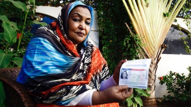 Sudanese citizen Fatima Abul Qasim Gash shows her US visa in her passport during an interview with AFP in Khartoum on January 29, 2017 after she was turned back at Doha airport after US President Donald Trump signed a sweeping executive order to suspend refugee arrivals and impose tough controls on travellers from Iran, Iraq, Libya, Somalia, Sudan, Syria and Yemen, speaks during an interview with AFP in Khartoum on January 29, 2017