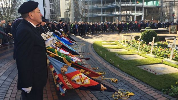Veterans observe a two minute silence outside Birmingham's Hall of Memory
