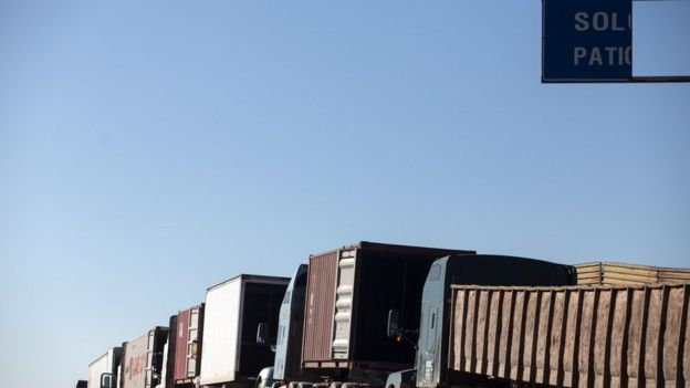 Trucks line up at the Mexico-United States border
