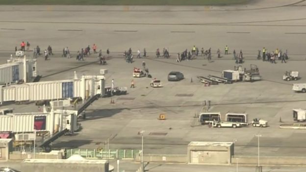Hundreds of people have been forced to wait on the airport tarmac for police to clear the terminal