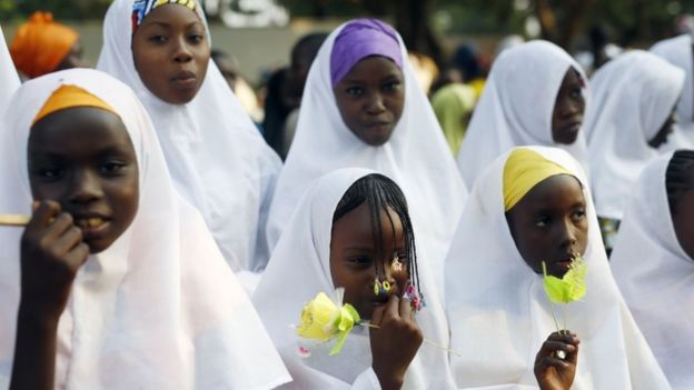 Children wait for the arrival of Pope Francis on the occasion of his visit at the Central Mosque in Bangui