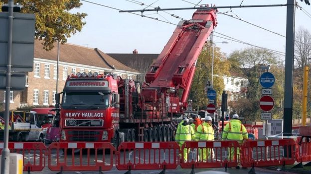 A crane is raised into position at the scene near the tram crash in Croydon,