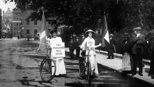 13th July 1914: Two suffragettes advertising a meeting at which Emmeline Pankhurst (1858 - 1928) will speak