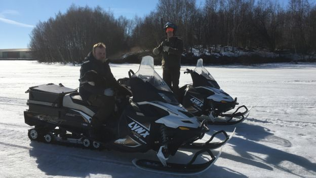 Ludde Noren (left) and Per-Arne Ahlen, raccoon dog hunters, on snow tractors in northern Sweden