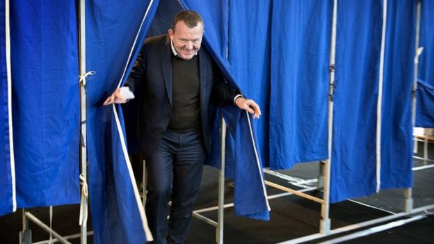 Danish Prime Minister Lars Lokke Rasmussen leaves a voting booth