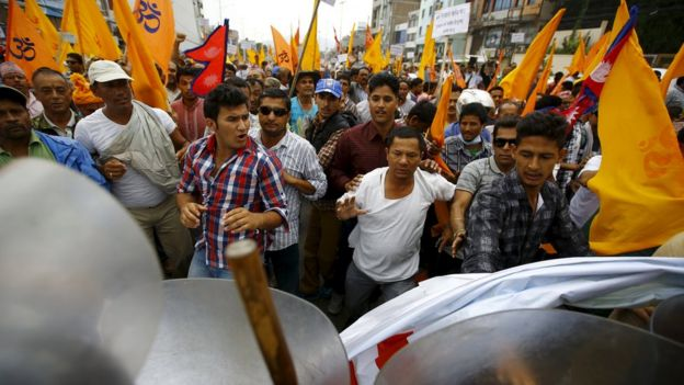 Hindu activists march forward while trying to break through a restricted area near the parliament during a protest rally demanding Nepal to be declared as a Hindu state in the new constitution, in Kathmandu, Nepal September 14, 2015.