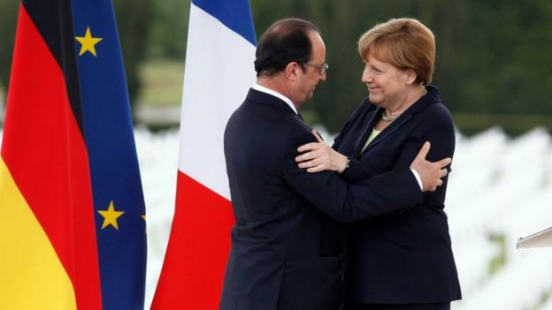 French President Francois Hollande (L) greets German Chancellor Angela Merkel (R) after delivering speeches to mark the centenary of the battle of Verdun