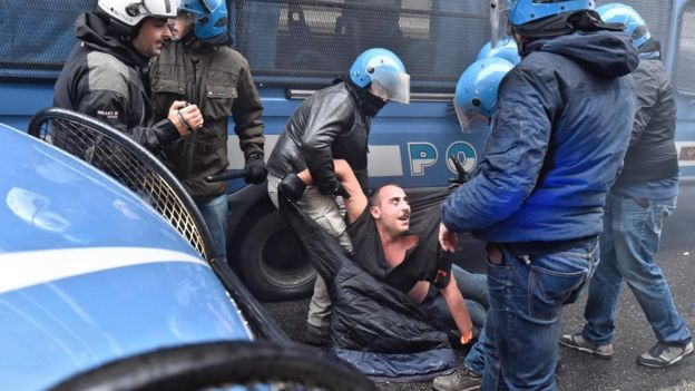 A protestor is arrested during clashes between police and protesters at an anti-government demonstration in Florence