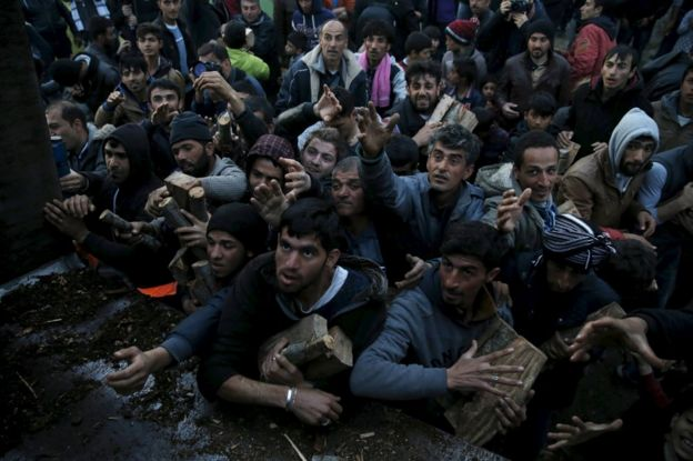 Migrants scuffle over firewood near Greece's Idomeni border crossing with Macedonia, 6 March