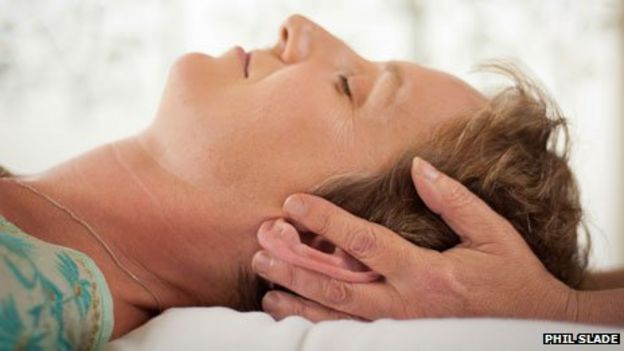 Grainne Warner receiving a reiki treatment from Tripuri Dunne   both are reiki practitioners BBC