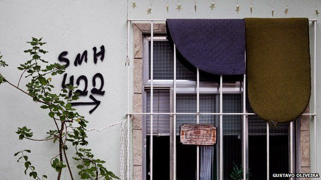 SMH can be seen spray painted onto a wall in Vila Uniao in January 2015