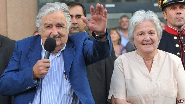 Uruguayan President Jose Mujica with his wife Lucia Topolansky during a farewell ceremony in Montevideo - 27 February 2015