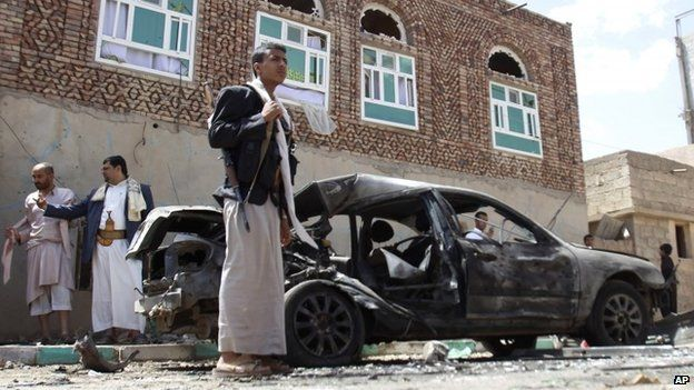 Houthi fighters stands next to a damaged after a suicide bomb attack on a mosque in Sanaa, Yemen (20 March 2015)