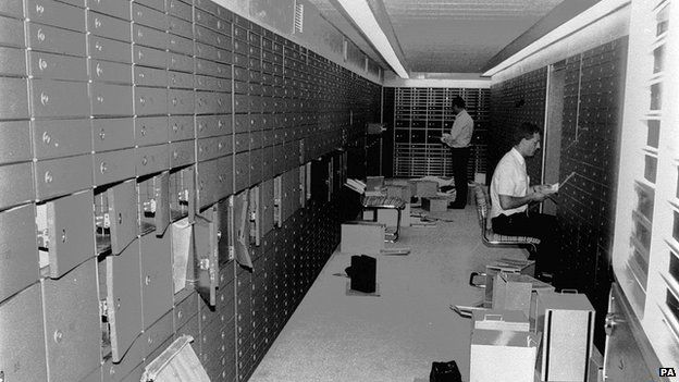 Police officers checking the raided boxes in the vault of the Knightsbridge Safe Deposit Centre in Knightsbridge, London, in July 1987