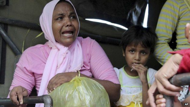 An ethnic Rohingya woman who was on one of the boats washed ashore on Sumatra island weeps as she boards a military truck heading to a temporary shelter in Seunuddon, Aceh province, Indonesia, Sunday, May 10, 2015