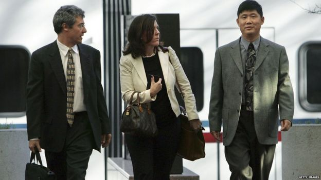 Xiaodong Sheldon Meng (R) arrives at the Robert F. Peckham Federal Building and U.S. Courthouse with his attorneys December 18, 2006 in San Jose, California.