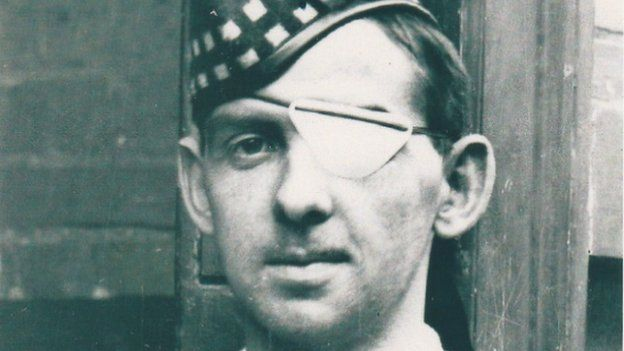 Image caption Lance Corporal William Angus lost an eye after being wounded during the rescue ... - _83585898_william_angus_eye_patch
