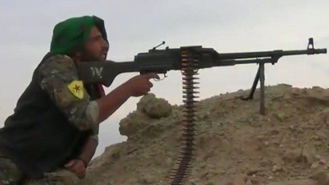 Man using a machine gun during a battle in Turkey