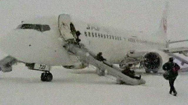 Passengers escape the plane