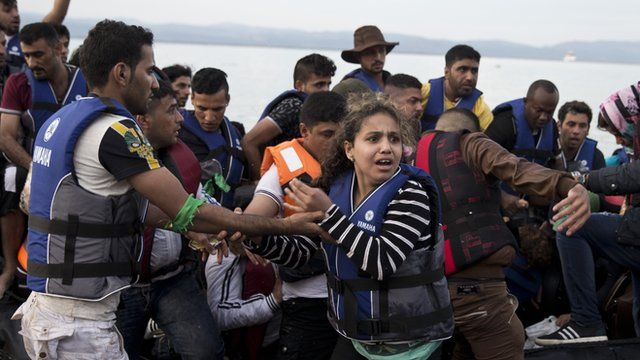Syrian refugees arriving on a boat