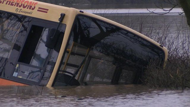 Bus trapped in flood water near York