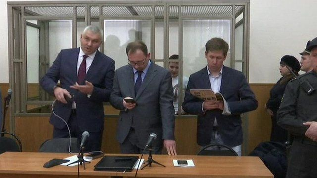 Nadiya Savchenko in court with her lawyers in front of her