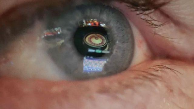 an eye reflecting a roulette wheel