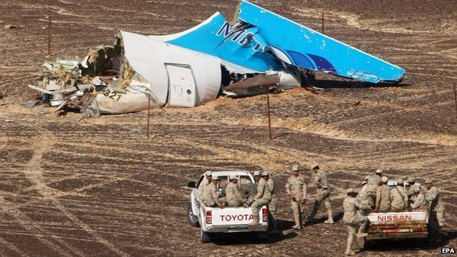 A handout picture provided by the Russian Emergency Ministry press service on 02 November 2015 shows Egyptian servicemen approaching a piece of wreckage of Russian MetroJet Airbus A321 at the site of the crash in Sinai