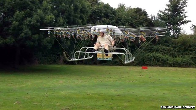 A multi-rotor drone carrying a man
