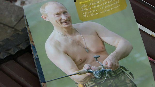 Putin, bare-chested holding his fishing rod - a calendar image