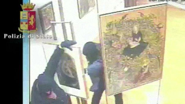 Thieves taking a painting