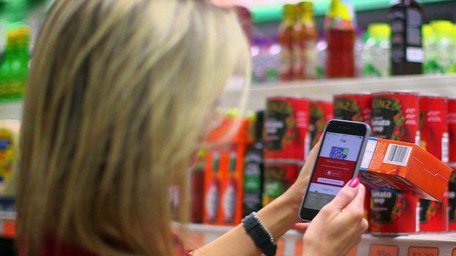 BBC Click's Lara Lewington uses a smartphone app in a supermarket