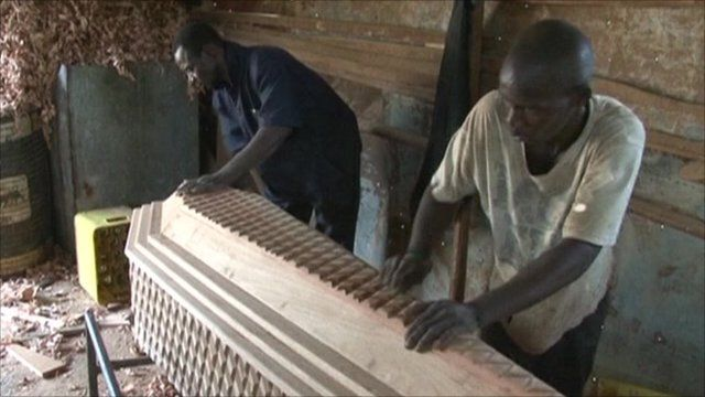 Men making a coffin in Sierra Leone