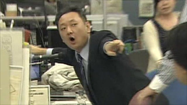 Office worker points as earthquake hits