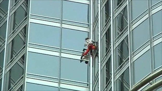 The French climber scales the skyscraper