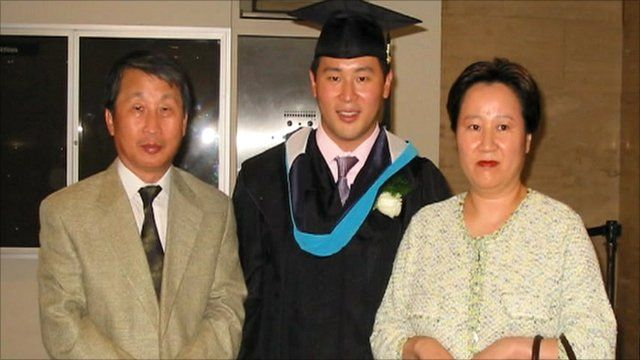 Ron Kim, centre, with parents SeoJun and Sunhee Kim