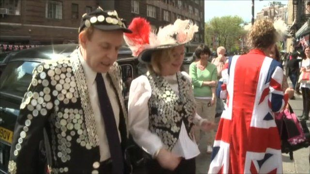 A Pearly king and queen at a street party in New York
