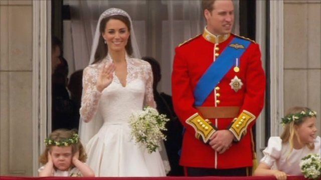 Bridesmaid covers her ears as she stands next to Kate Middleton and Prince William