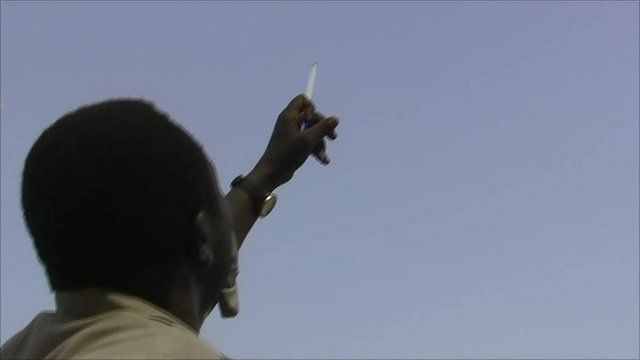 Man watching for strikes in Sudan