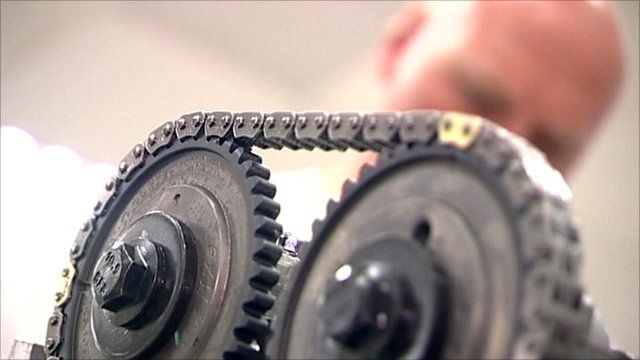 Cogs and chain in engineer's workshop