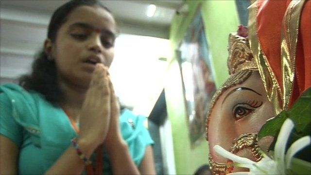Teenage girl taking a class to become a hindu priest