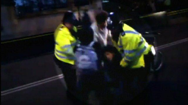 Police and disabled man in London student protests