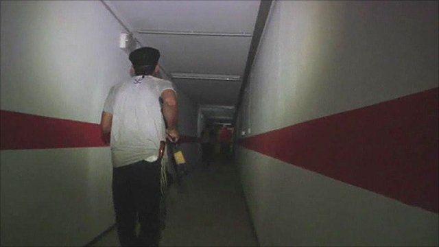 Rebel fighter in tunnel beneath Gaddafi compounds