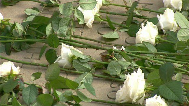 Flowers laid at memorial garden in Grosvenor Square