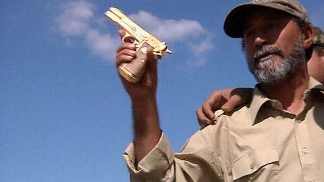 NTC fighter with 'Gaddafi's gun'
