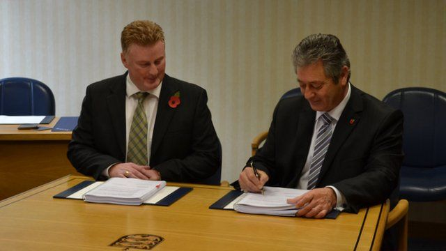 Guernsey Airport contract signed by Public Services Minister Bernard Flouquet and Lagan's managing director Colin Loughran
