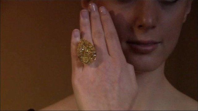 Model wears 110-carat yellow diamond ring